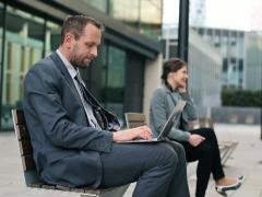 Business people with laptop and cellphone in the city NTSC Stock Footage
