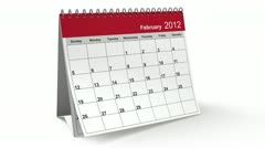 folding 2012 red desktop calendar - stock footage