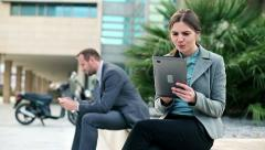 Business people with tablet computer and smartphone in the city HD - stock footage
