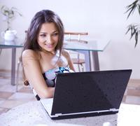 Woman in internet cafe Stock Photos