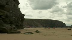 Pans of a surfing beach in cornwall Stock Footage