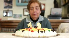 birthday ,blowing out candles on bithday cake (slow motion) - stock footage