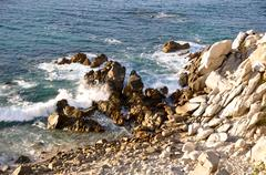 Rocks and Cliffs leading to Ocean Stock Photos