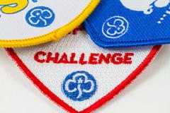 Girl guiding challenge badges Stock Photos