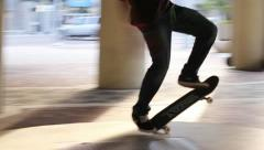 Skateboarder ollies downtown Stock Footage