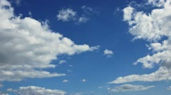 White clouds on blue sky. Time-lapse motion background 1080p - stock footage