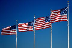 US flags flapping in wind Stock Photos