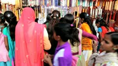 Traditionally dressed women market stall, Pushkar, India Stock Footage