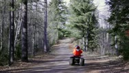 Stock Video Footage of Hunting season - riding four wheeler in woods, blaze orange