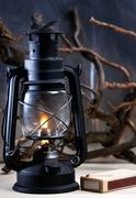 Vintage burning lantern against grunge backgrounds. abstract still life Stock Photos