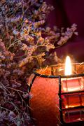 still-life with burning candle and heather - stock photo