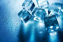 ice cubes over wet backgrounds with back light - stock photo