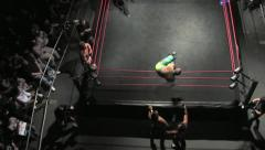 Pro Wrestling Match - Corkscrew Dive to Outside Ring HD - stock footage