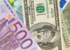 money background from dollars and euro banknotes - stock photo