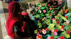 Artificial flower seller Pushkar, India - stock footage