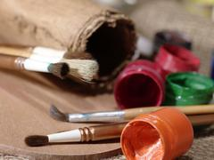 abstract art still life with paint and brushes - stock photo