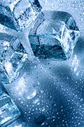 ice with water droplets over abstract wet background - stock photo