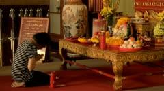 Woman Praying at a Shrine to Kwan Yin (Kuan Im) Stock Footage