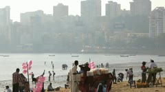 People on Chowpatty Beach Mumbai, India, T/Lapse - stock footage