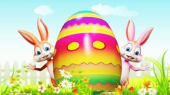 Easter Bunny with a big colorful egg Stock Footage