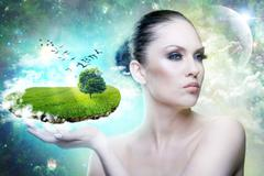 world of magic. female portrait with abstract world in hand - stock photo