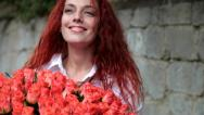 Young woman enjoying bunch of fresh flowers Stock Footage