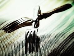 pair. abstract kitchen still life with two fork - stock photo