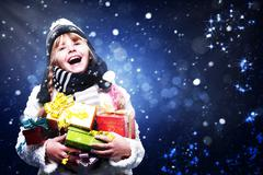 Happy young girl with many christmas gifts, abstract art backgrounds Stock Photos
