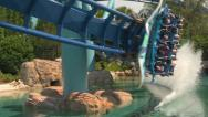 Stock Video Footage of Flying Rollercoaster Sharp Corner Close to Water with Sound