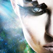 Alien look, abstract female portrait against space backgrounds Stock Photos