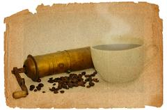 Coffee mill and beans Stock Photos