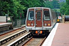 Metro unit leaves station Stock Photos