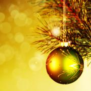 Xmas decoration ball over abstract golden backgrounds with beauty bokeh Stock Photos