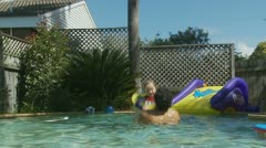 Father playing with his children in swimming pool (12) model release Stock Footage
