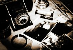 Still life. vintage stylized lithprint with retro photo camera and old photos Stock Photos