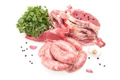 Raw steaks and sausages Stock Photos