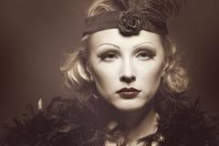 Woman's retro revival portrait. 30's of the xx century. professional makeup Stock Photos