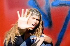 Angry rebellious teen hand up to say no Stock Photos