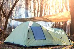 tent in forest - stock photo