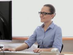 Attractive businesswoman working on computer in the office NTSC Stock Footage