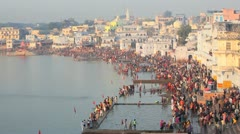 Pilgrims bathing in the Holy Lake at Puskar, India - stock footage
