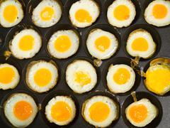 kind of thai sweetmeat made from partridge eggs (kanom krok kai nok krata) - stock photo