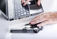 computer criminal in action - stock photo
