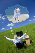 businessman dreaming vacation retirement desk green field - stock photo
