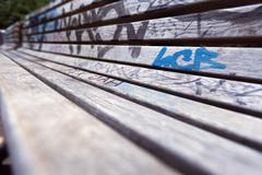 Grafitti covered bench Stock Photos