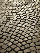 Cobblestone paved street Stock Photos
