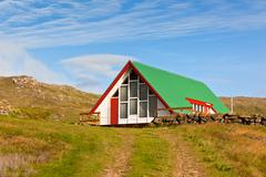bright siding houses in small iceland town - stock photo