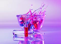 Stock Photo of medical ampoules still life in vivid violet colors