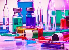 Medical laboratory glass equipment still life on blue purple Stock Photos