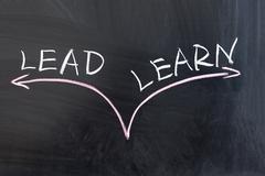 Lead or learn Stock Photos